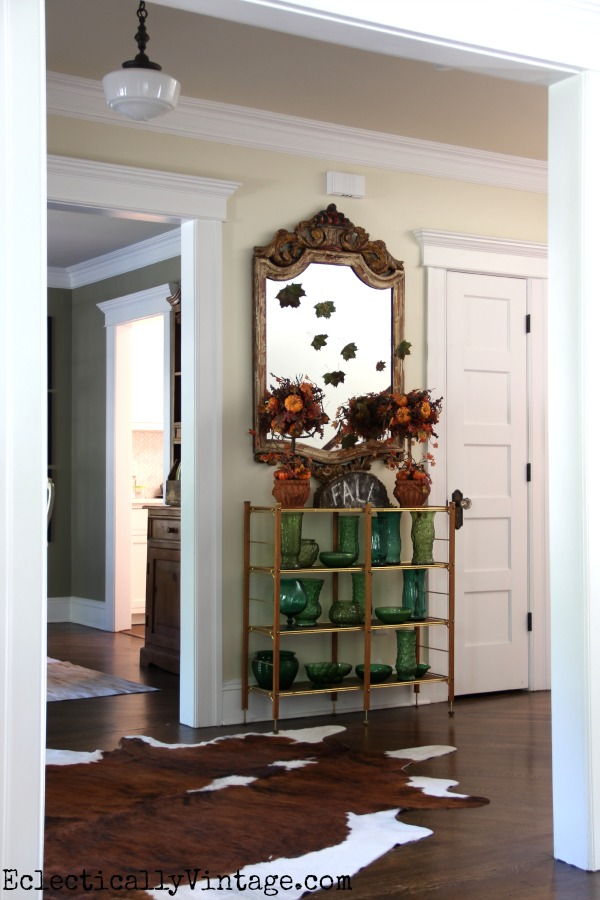 What a fun fall foyer - love the falling leaves on the mirror eclecticallyvintage.com #EclecticallyFall
