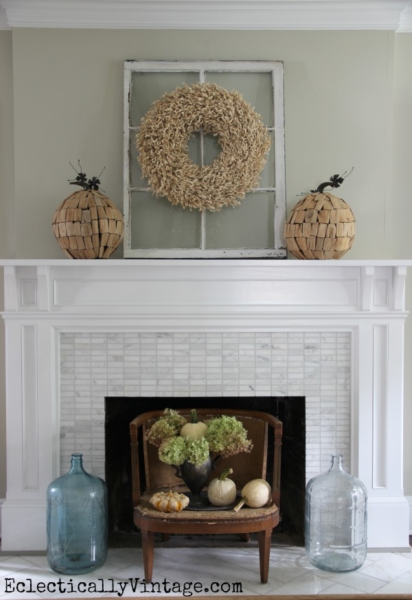 Creative Fall Decorating Ideas Home Tour - love the driftwood pumpkins and the little chair fireplace screen! kellyelko.com