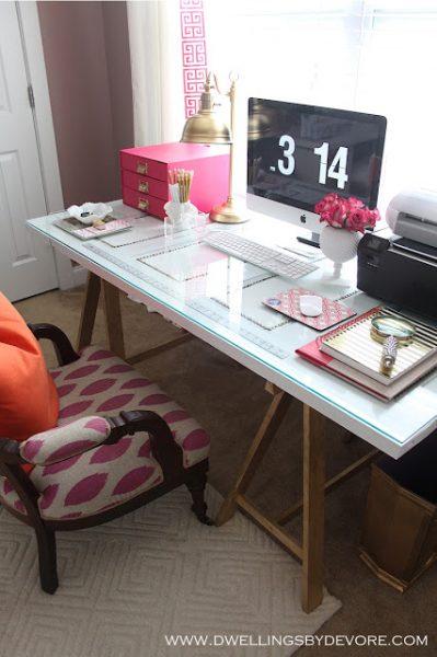 Sawhorse desk - love the fun pops of pink kellyelko.com