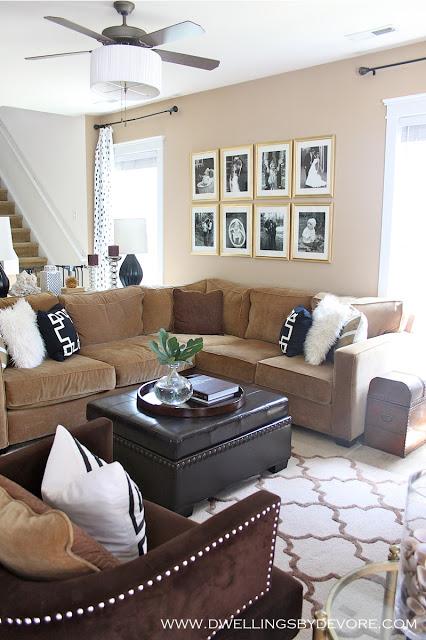 Cozy living room - love the gallery wall of framed photos kellyelko.com