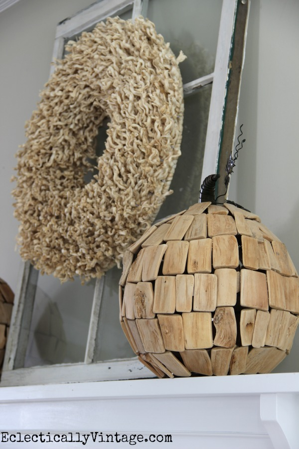 I love the texture on this neutral wreath and that driftwood pumpkin! kellyelko.com