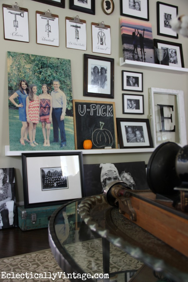 What a creative picture ledge gallery wall (love the corkscrew free printables too)! kellyelko.com