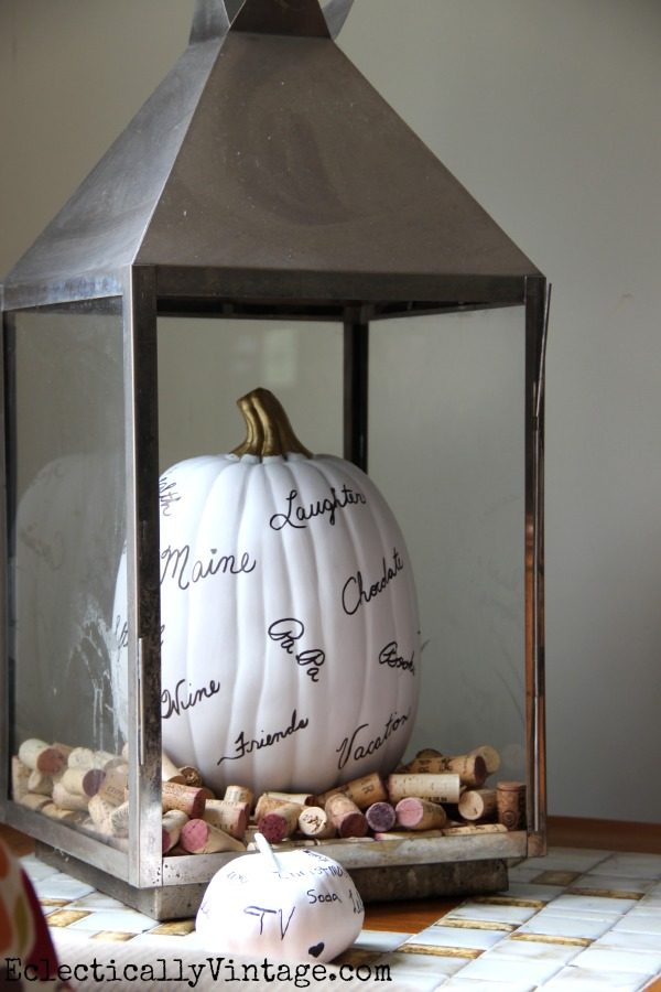 Thankful pumpkin in a lantern - love the corks too! kellyelko.com #EclecticallyFall