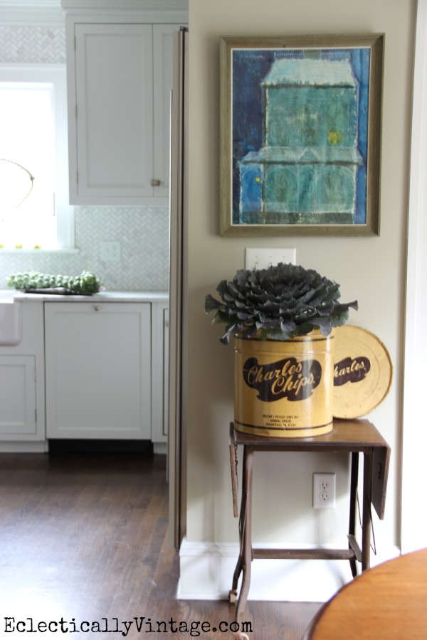 This kitchen is gorgeous and fun!  Love the old Charles Chips container as a vase eclecticallyvintage.com #EclecticallyFall