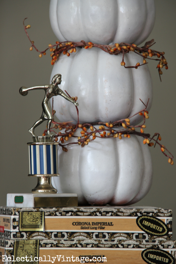 Cute pumpkin topiary - love it propped on the old cigar boxes eclecticallyvintage.com #EclecticallyFall