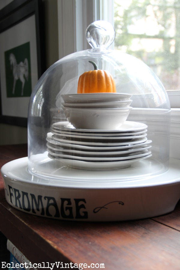 Fun way to display favorite plates - under a cloche eclecticallyvintage.com #EclecticallyFall