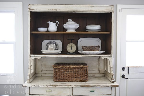 Beautiful chippy white cabinet is perfect for displaying an ironstone collection kellyelko.com