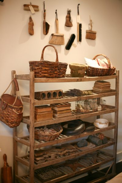 A vintage bakers rack is perfect for display - love the old hand broom collection kellyelko.com
