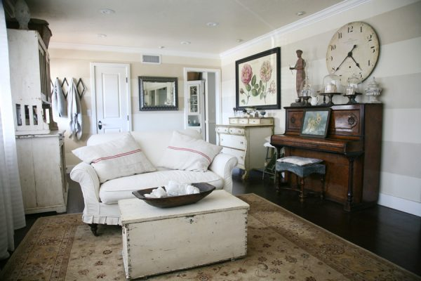 Casual living room filled with vintage collections - love the old piano and huge clock! kellyelko.com