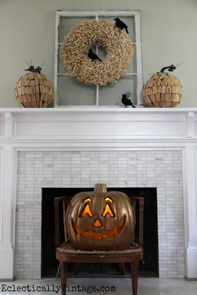 Halloween mantel - a few black crows on a wreath and a copper jack o lantern turn fall into Halloween kellyelko.com