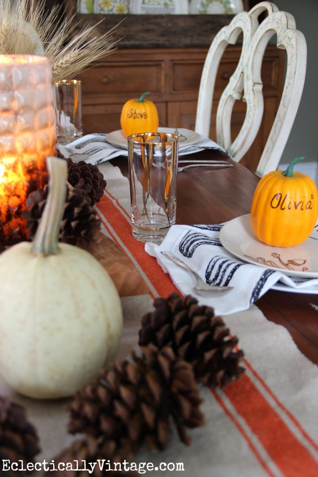Love the way this table is set for fall - the pumpkin place settings are cute! kellyelko.com