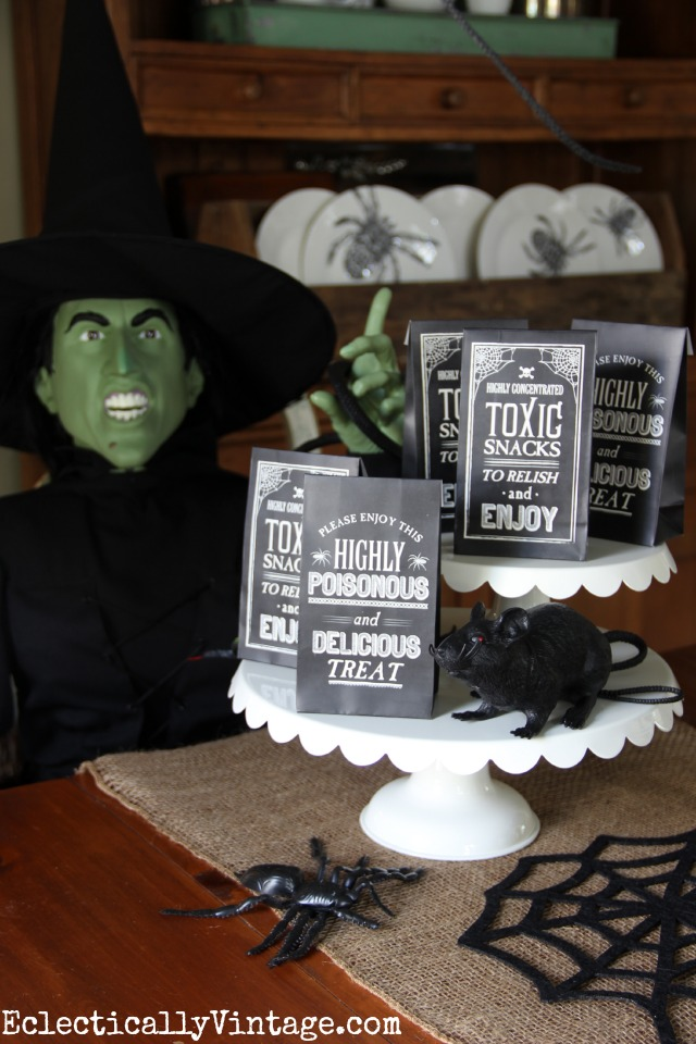 Easy Halloween Party Decorations - love the life-size Wicked Witch of the West! kellyelko.com