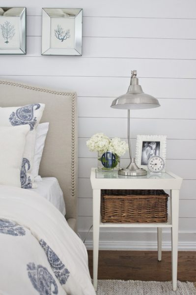 Beautiful bedroom with planked walls and blue nautical accents kellyelko.com