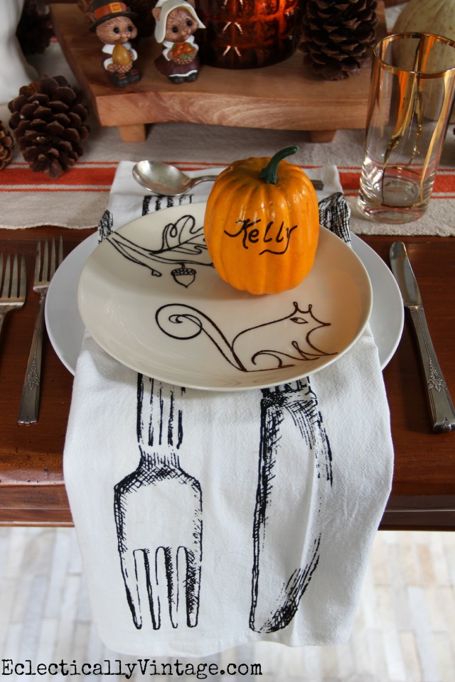 Thanksgiving Table Ideas - love everything about this from the pumpkin place settings to the squirrel plates to those fabulous napkins! kellyelko.com