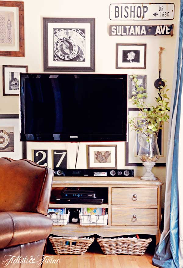Collected gallery wall around a tv kellyelko.com