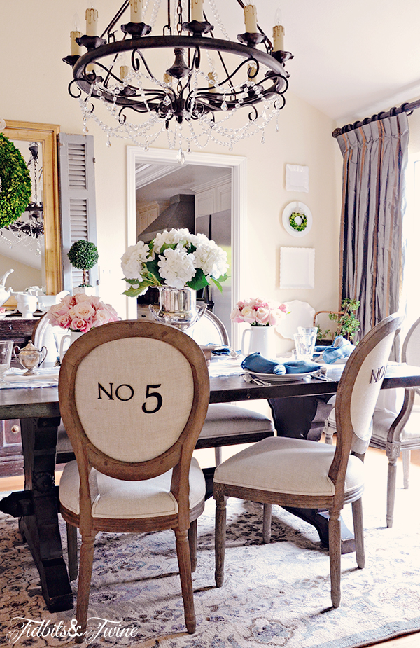 Eclectic Home Tour of Tidbits and Twine - love the numbered dining room chairs kellyelko.com