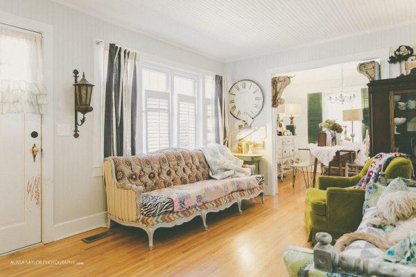 Antique sofa with modern mix of different upholstery fabrics - even zebra print! kellyelko.com