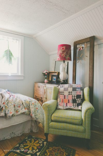 Vintage green chair is the perfect cozy reading spot in a bedroom kellyelko.com