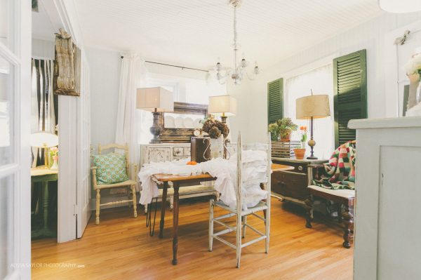 Cozy cottage kitchen with fun mismatched furniture - love the shutters framing the window kellyelko.com