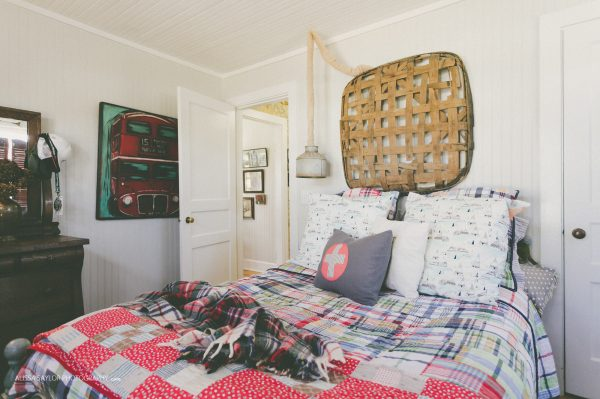 Vintage flea market quilts and tobacco basket add charm to this cottage bedroom kellyelko.com