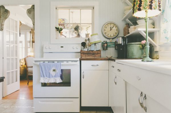 Vintage kitchen with lots of charming details like the double drainboard sink kellyelko.com