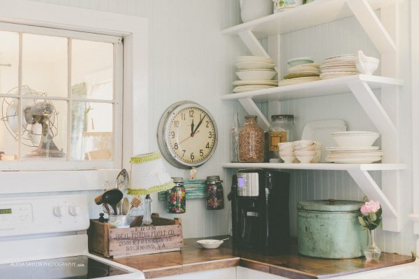 Charming cottage kitchen with open shelves for displaying collections kellyelko.com