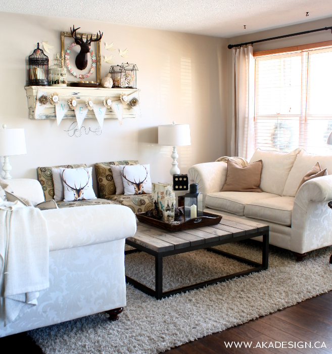 Beautiful neutral living room - love the cozy throws and deer pillows kellyelko.com