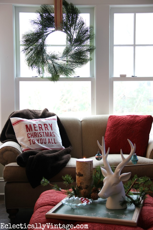 Christmas decorating ideas - love this cozy family room with the fur throw and the festive wreath kellyelko.com