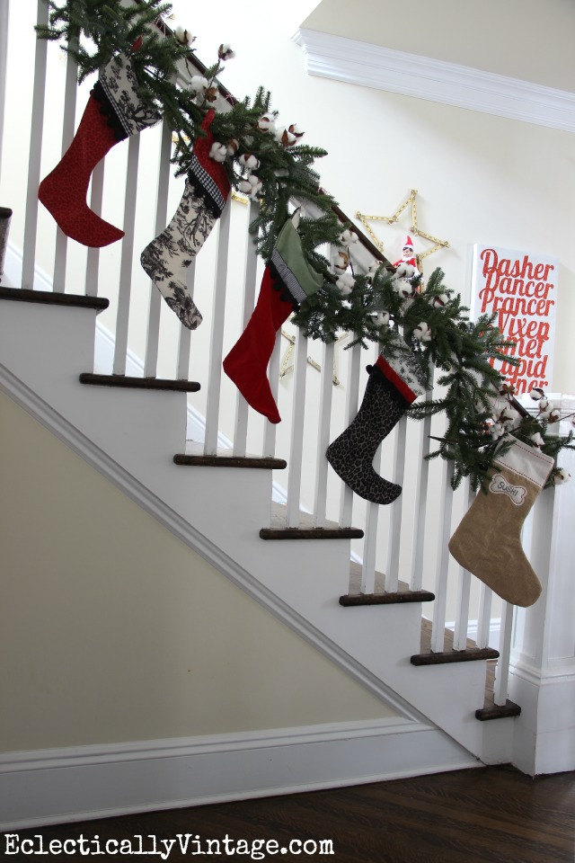 The stockings were hung on the Christmas bannister with care - love the fun stocking prints and the little dog stocking! kellyelko.com