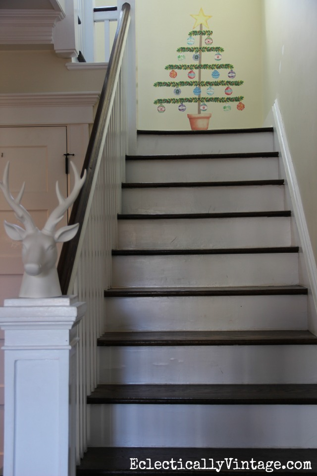 How cute is that Christmas tree decal! Perfect for tight spaces like this stairway landing kellyelko.com