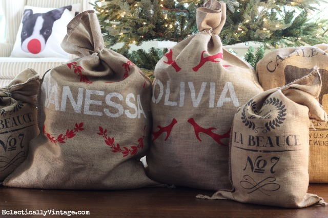 Make these adorable DIY Personalized Grain Sacks - such cute little Santa Sacks under the tree! kellyelko.com