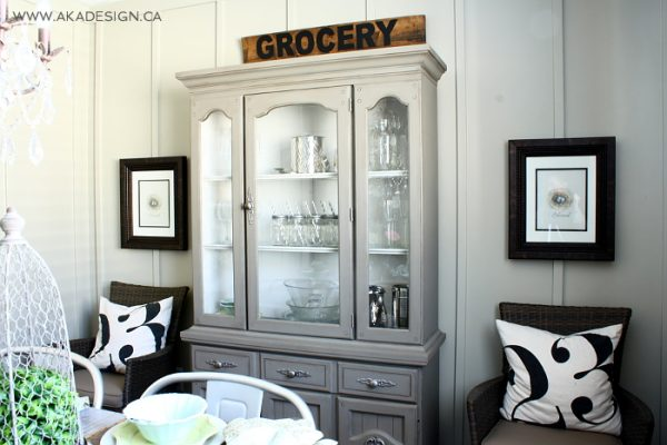Love this dining room - the gray hutch and the cute numbered pillows kellyelko.com