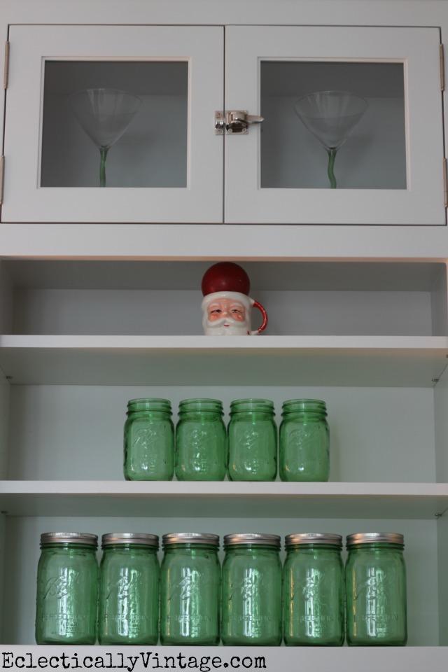 Mason jar Christmas tree with a vintage Santa mug tree topper! kellyelko.com