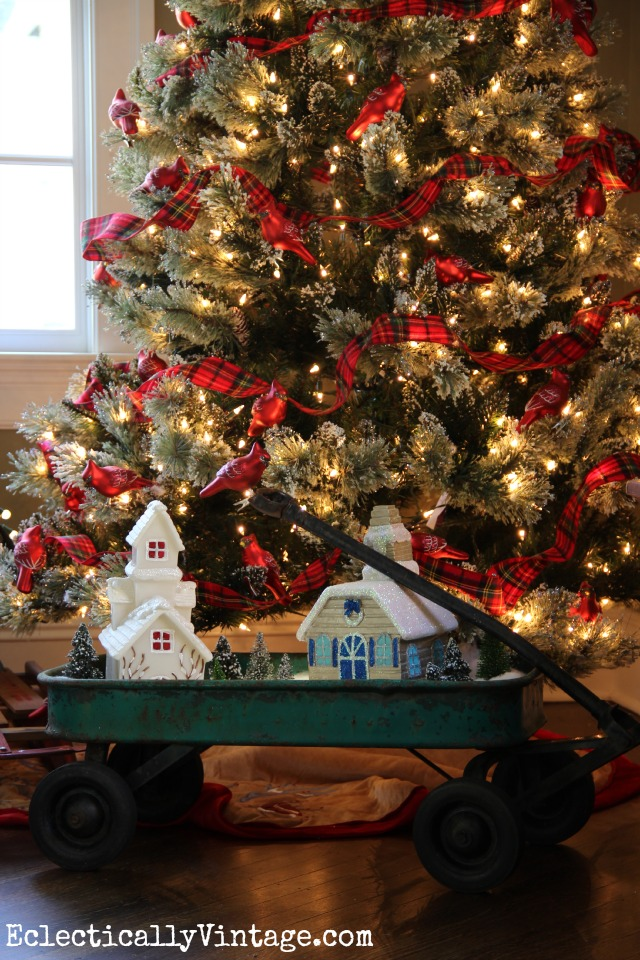 i love this festive plaid and cardinal themed christmas tree and the cute snow village