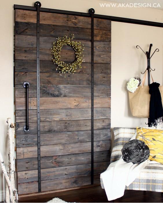 Make a DIY barn wood rolling door with pallets kellyelko.com