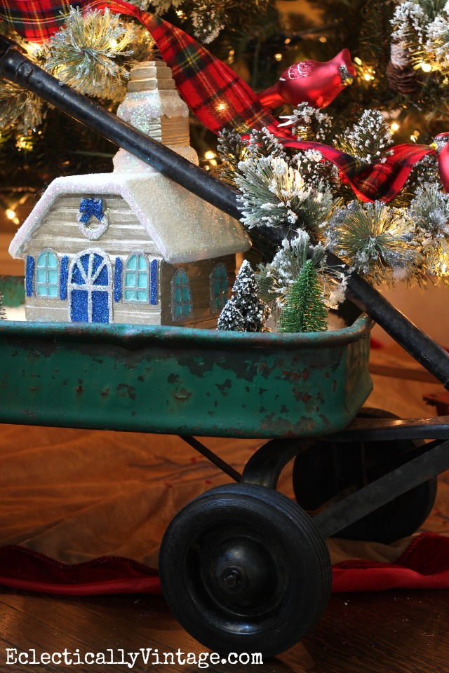 A vintage wagon holds the cutest Christmas snow village - see how to make your own that lights up kellyelko.com