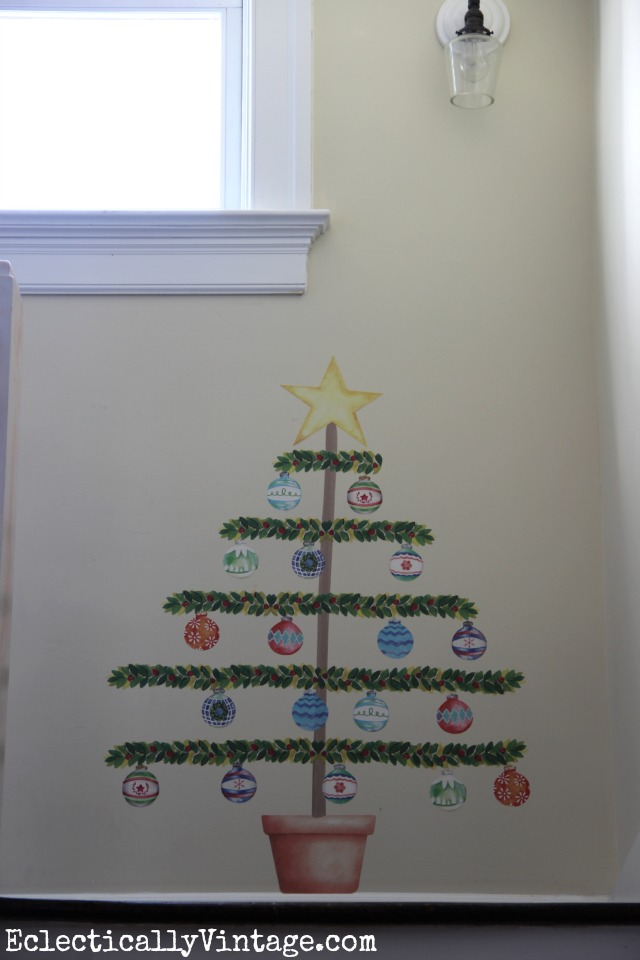 I love this Christmas tree decal - now you can have a tree where one would never fit! kellyelko.com