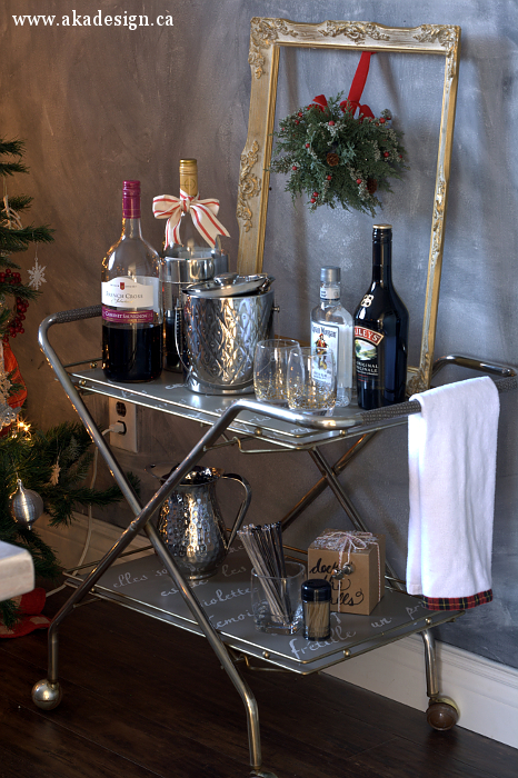 Update an old rolling cart into a cute bar cart with a little paint and stencil kellyelko.com