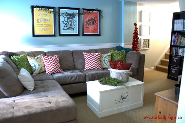 Colorful family room - love the sectional with the different patterned pillows kellyelko.com