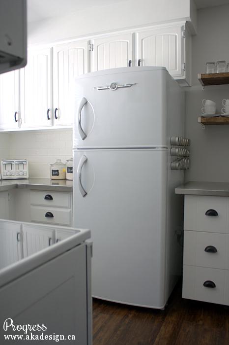 Love this retro refrigerator in this white cottage kitchen kellyelko.com