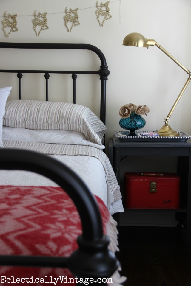 Love the brass pharmacy style lamp and the vintage typewriter table as a nightstand kellyelko.com