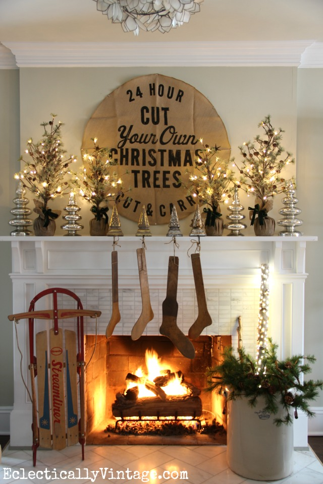 Rustic Christmas mantel with antique wood stockings - one of five creative Christmas mantels kellyelko.com
