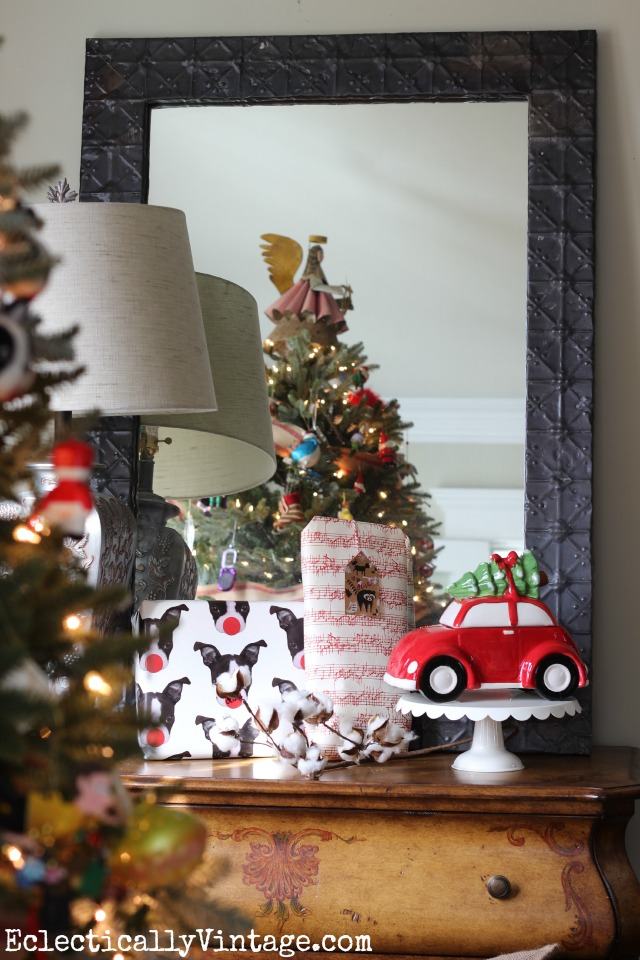 Love this festive family Christmas tree - and the angel tree topper! kellyelko.com