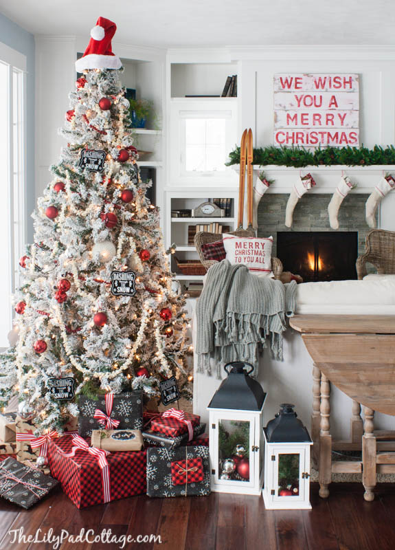 Cozy Christmas house - love the flocked tree kellyelko.com