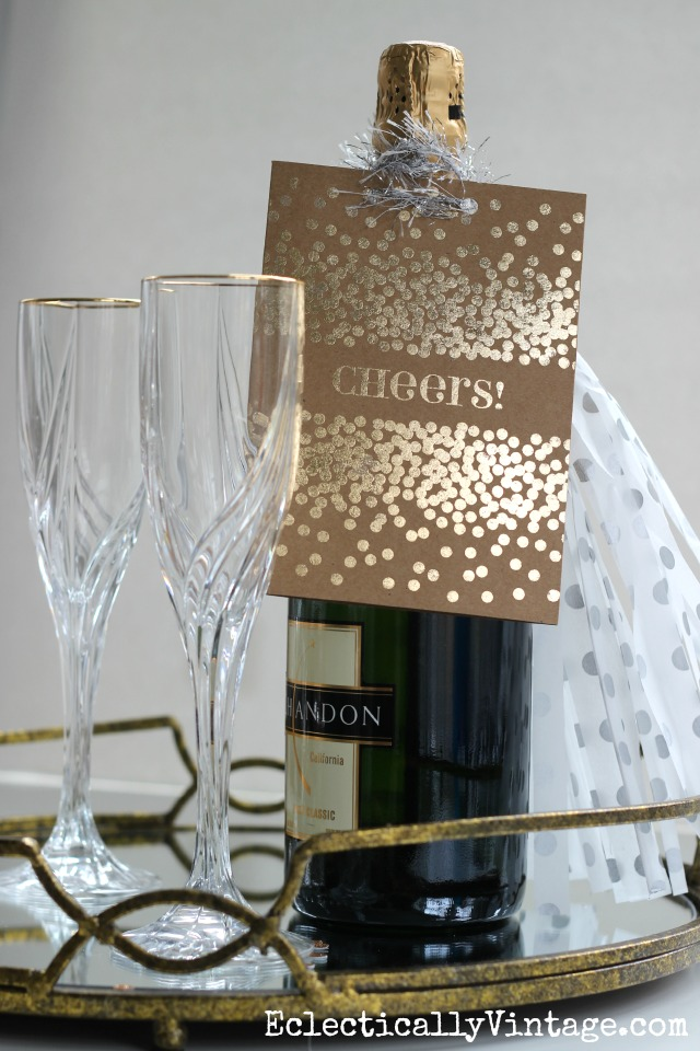 Love this DIY Gold Foil card used on a bottle of bubbly - the perfect hostess gift kellyelko.com
