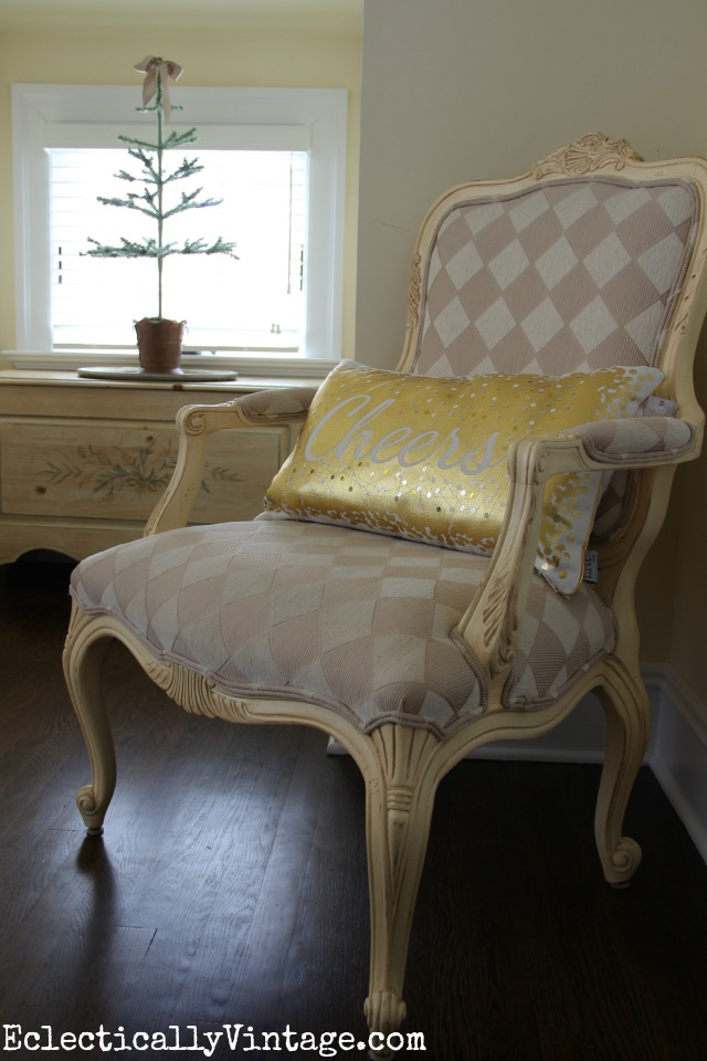 Love this little bedroom nook and the harlequin pattern chair (and Cheers pillow)! kellyelko.com
