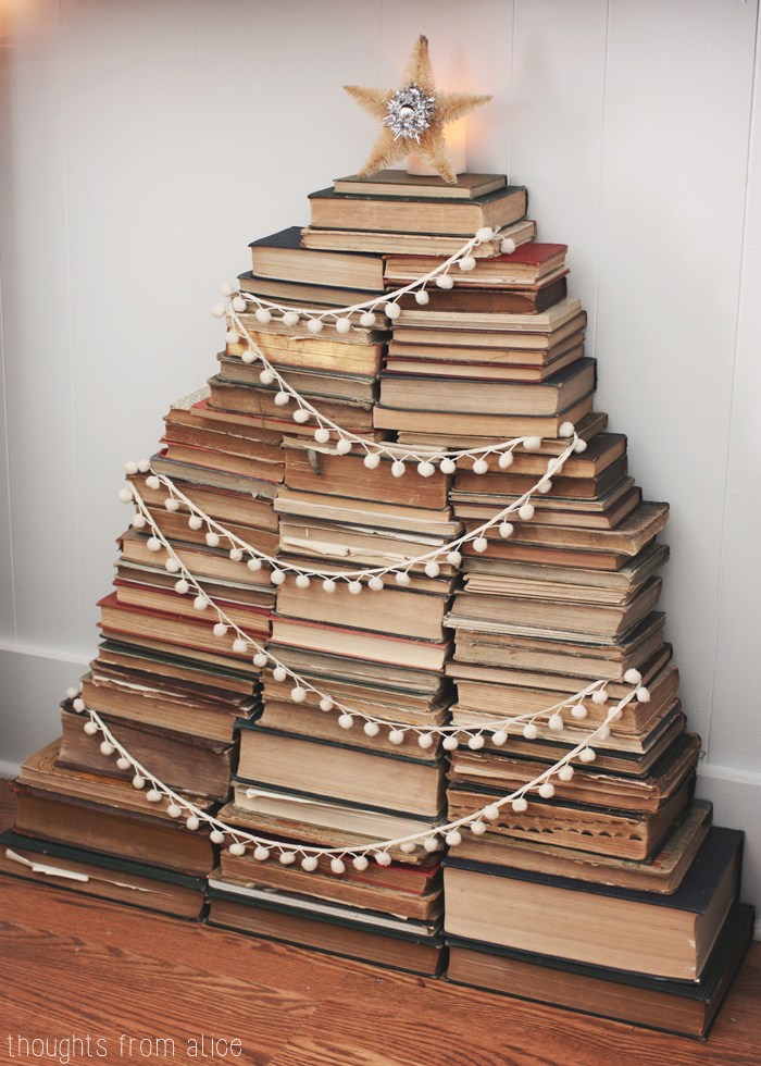 Cute stacked Christmas book tree complete with shining star! kellyelko.com