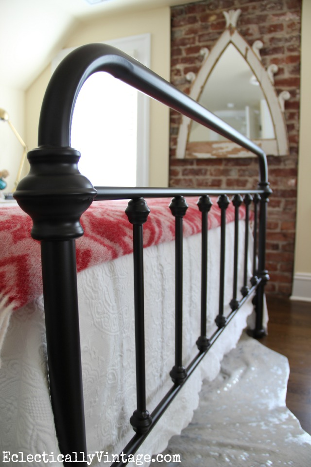 Love this vintage style iron bed - look at the footboard! kellyelko.com