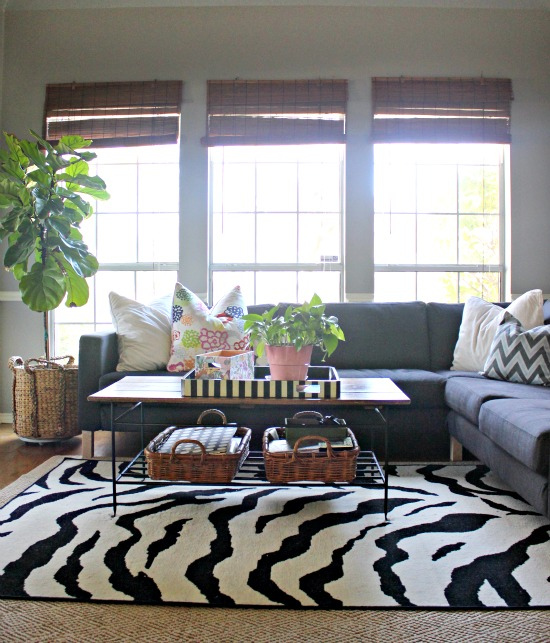 Modern sectional sofa with colorful pillows and zebra rug kellyelko.com