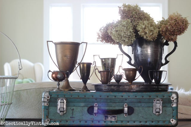 Antique loving cups - love the way they are displayed kellyelko.com